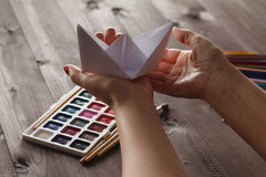 Female ready lesson to educare do paper craft origami Stock Photos