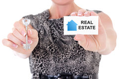 Female real estate agent hands holding key and visiting card iso. Lated on white background Royalty Free Stock Photo