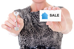 Female real estate agent hands with key and visiting card isolat Stock Photo