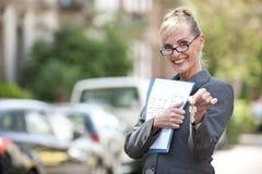 Female Real Estate Agent holding house key Royalty Free Stock Image