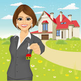 Female real estate agent holding the key of a new house. Portrait of female real estate agent holding the key of a new house royalty free illustration