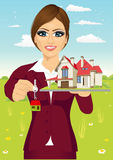 Female real estate agent holding a model house. Female real estate agent holding a model and the key of a new house royalty free illustration
