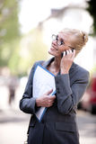 Female Real Estate Agent talking on phone Stock Photo