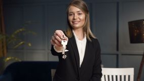 Female realtor giving the keys from apartment to the camera. stock video footage