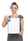 Female realtor holding blank clipboard and keys Stock Photos