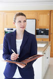 Female Realtor Looking Around Vacant New Property stock photos