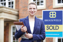 Female Realtor Standing Outside Residential Property Royalty Free Stock Image