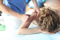 Female receiving arm,shoulder massage Stock Image