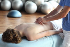 Female receiving back massage Stock Photos