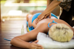 Female receiving back massage Royalty Free Stock Images