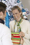 Female Receiving Christmas Gift From Man Stock Images