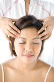 Female receiving gentle and relaxing head massage. Young female receiving gentle and relaxing head massage Royalty Free Stock Photos