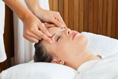Female Receiving Head Massage At Spa Stock Image