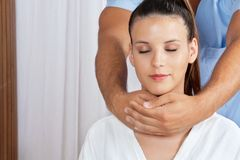Female Receiving Neck Massage Royalty Free Stock Photos