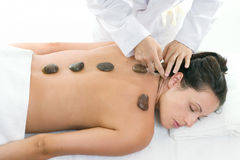 Female receiving a relaxing massage treatment royalty free stock image
