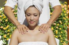 Female Receiving Shoulder Massage Stock Photos