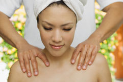 Female Receiving Shoulder Massage Royalty Free Stock Image