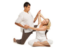 Female receiving traditional thai massage Royalty Free Stock Photography