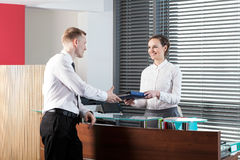 Female receptionist and businessman Royalty Free Stock Photos