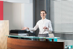 Female receptionist showing welcome gesture Stock Photos