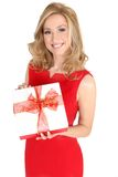 Female in red dress holding a present stock images