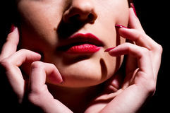 Female red gloss lips with hands Stock Image