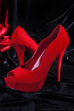 Female red high-heeled shoes. Royalty Free Stock Photos
