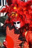 Female red mask and feathers, Venice, Italy, Europe Royalty Free Stock Images