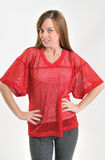 Female in red mesh sports jersey Royalty Free Stock Images
