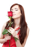 Female with red rose on white Royalty Free Stock Image