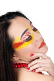 Female with red and yellow makeup Stock Photography