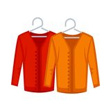 Female red and yellow sweaters on hangers isolated on white Royalty Free Stock Photography