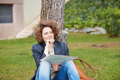 Female redhead art student drawing outdoors Royalty Free Stock Image