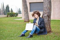 Female redhead art student drawing outdoors Royalty Free Stock Images