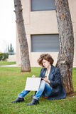 Female redhead art student drawing outdoors Royalty Free Stock Photo