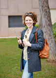 Female redhead student carrying notebook and coffee to go Royalty Free Stock Photo