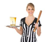 Female referee with beer and baseball bat Royalty Free Stock Photography