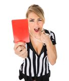 Female referee holding red card Stock Photos