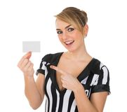 Female referee showing card Stock Photography