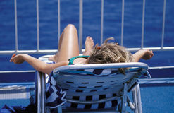 Female Relaxing. On a cruise ship while on vacation Royalty Free Stock Photos