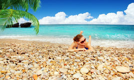Female relaxing on the beach Stock Image