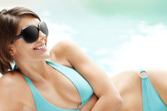 Female relaxing in bikini and sunglasses Stock Images