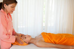 Female relaxing with a massage Stock Photos