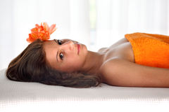 Female relaxing with a massage Stock Images