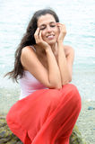 Female relaxing with sea on background Stock Photography