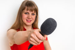 Female reporter with black microphone making interview Royalty Free Stock Images