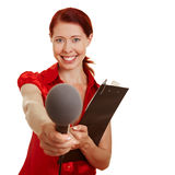 Female reporter doing a survey. With microphone and clipboard Royalty Free Stock Photos