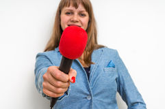 Female reporter at press conference with microphone. Journalism and broadcasting concept Royalty Free Stock Photography