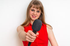 Female reporter at press conference with microphone Royalty Free Stock Images