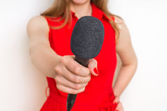 Female reporter at press conference with microphone. Journalism and broadcasting concept Royalty Free Stock Photo